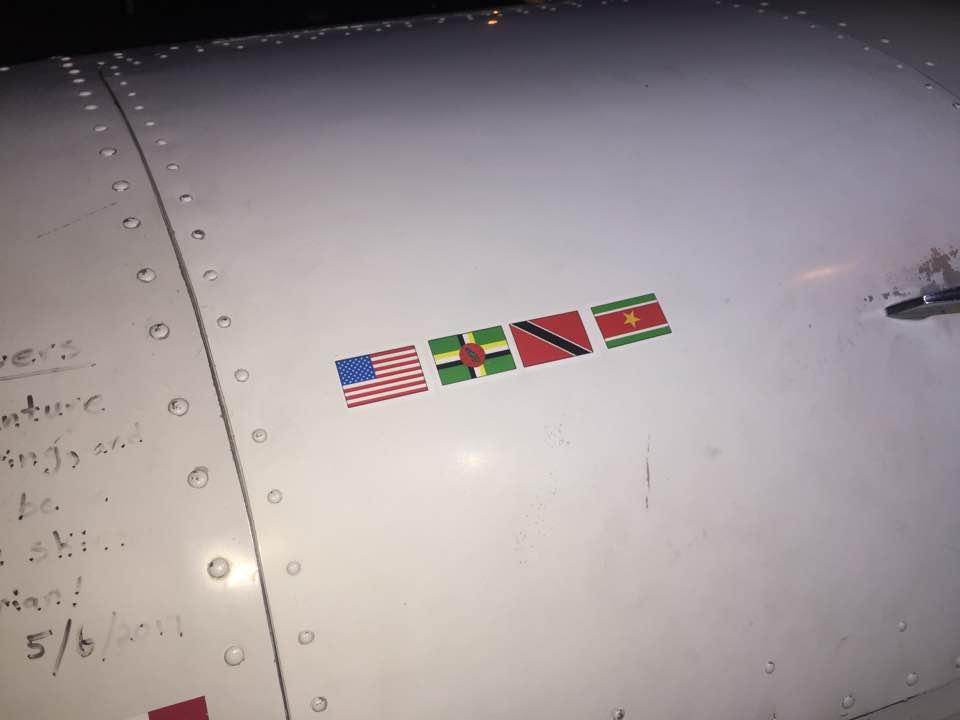Signatures and flags on Spirit at Paramaribo airport Suriname 3JUN2017. photo ©2017 Brian Lloyd