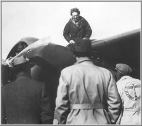 Amelia Earhart sits on her plane at Oakland airport in February 1935 after piloting the first female solo flight from Hawaii to California