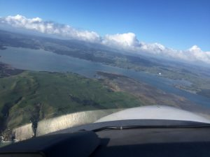 Looking at the bay over the nose of the Diamond DA42 over Raglan New Zealand photo 11 July 2017 by Brian Lloyd CC BY